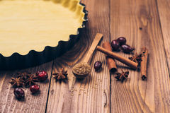Ingredients for apple tart, apples and cinnamon on rustic wooden background. Ingredients for apple tart, apples and cinnamon on the rustic wooden background Stock Photos