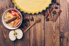 Ingredients for apple tart, apples and cinnamon on rustic wooden background. Ingredients for apple tart, apples and cinnamon on the rustic wooden background Stock Images
