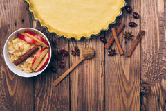 Ingredients for apple tart, apples and cinnamon on rustic wooden background. Ingredients for apple tart, apples and cinnamon on the rustic wooden background Royalty Free Stock Photo