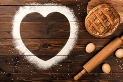Ingredients of a bakery on a wooden background stock images