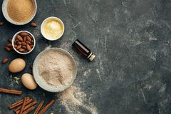 Ingredients for baking, almond flour, butter, sugar, eggs and spices. Royalty Free Stock Image