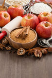 Ingredients for baking apple pie and wooden background Royalty Free Stock Photo