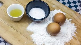 Ingredients for baking. Brown eggs, flour, salt and olive oil for baking Royalty Free Stock Photo