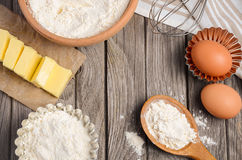 Ingredients for baking - butter, eggs and flour. Stock Image