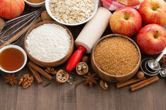 Ingredients for baking cake on a wooden background, top view Royalty Free Stock Photos