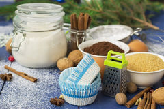 Ingredients for baking Christmas muffins on wooden background. s Stock Photo