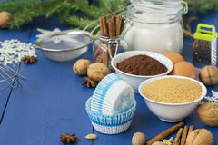 Ingredients for baking Christmas muffins on wooden background. s Stock Image