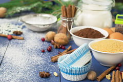 Ingredients for baking Christmas muffins on wooden background. s Stock Images