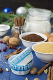 Ingredients for baking Christmas muffins on wooden background. s Royalty Free Stock Photos