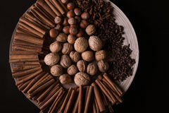 ingredients for baking, cinnamon sticks, star anise, cloves, nuts, coconut, coffee beans on a wooden background Stock Photo
