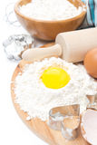 Ingredients for baking cookies - flour, egg and baking forms Stock Image