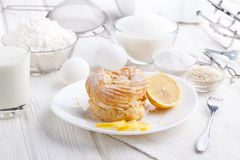 Ingredients for baking delicious cakes on a white wooden table. Fresh bakery Stock Photo