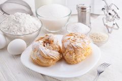 Ingredients for baking delicious cakes on a white wooden table Royalty Free Stock Photography