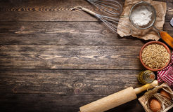 Ingredients for baking on empty dark wooden background with plac Royalty Free Stock Photo