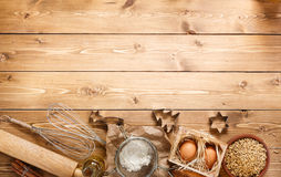 Ingredients for baking on empty light wooden background with pla Royalty Free Stock Photos