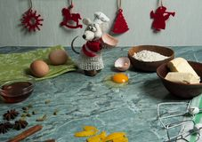 Ingredients for baking festive gingerbread, funny rat in a cap and apron, flour, honey, butter, spices. Christmas, winter, New yea
