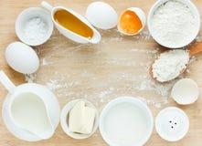 Ingredients for baking - flour, eggs, salt, sugar, butter, milk. Stock Images