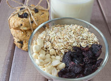 Ingredients for baking healthy cookies with pile of ready cookies and glass of milk Royalty Free Stock Photography