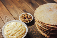 Ingredients for baking homemade cake. shortcakes, buttercream or cream and nuts Royalty Free Stock Photo