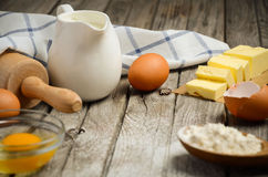 Ingredients for baking - milk, butter, eggs and flour. Royalty Free Stock Photo