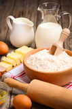 Ingredients for baking - milk, butter, eggs and flour. Royalty Free Stock Images