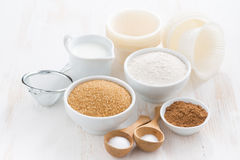 Ingredients for baking muffins on white table Stock Photos