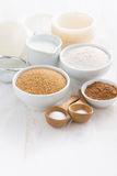 Ingredients for baking muffins on a white wooden background Royalty Free Stock Image
