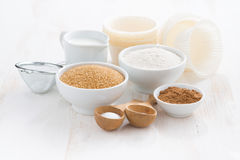 Ingredients for baking muffins on a white wooden background Stock Photo