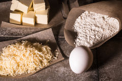 Ingredients for baking on pergament paper on grey stone table Royalty Free Stock Photography
