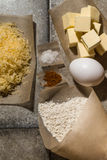 Ingredients for baking on pergament paper on grey stone table Royalty Free Stock Images