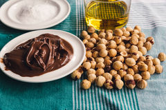 Ingredients for baking sweet cake with chocolate and hazelnuts Stock Photos