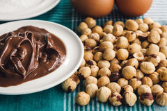 Ingredients for baking sweet cake with chocolate and hazelnuts Royalty Free Stock Photo