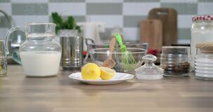 Ingredients for baking on table in home kitchen. Slider tracking shot