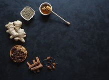 Ingredients for baking using ginger, cinnamon, cloves, dried fruit and hemp seeds. royalty free stock image