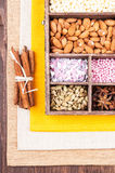 Ingredients for baking in a wooden box. On the background of linen napkins and wood Royalty Free Stock Image