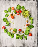 Ingredients for basil pesto on white wooden background, cirkel frame with place for text Stock Image