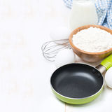 Ingredients for a batch of pancakes (with space for text). Ingredients for a batch of pancakes on white (with space for text royalty free stock photography
