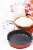 Ingredients for a batch of pancakes on white wooden table Royalty Free Stock Photography