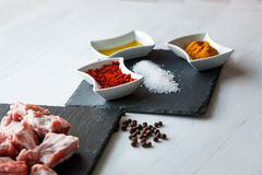 Ingredients for beef stew with olive oil, paprika and curry Royalty Free Stock Photography