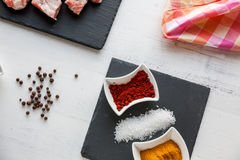 Ingredients for beef stew with olive oil, paprika and curry Royalty Free Stock Images