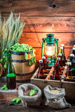 Ingredients for beer and bottles in the cellar Royalty Free Stock Photo