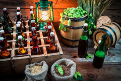 Ingredients for beer and bottles in the cellar Royalty Free Stock Photography