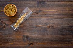 Ingredients for beer. Malting barley in beer glass on wooden background top view copyspace. Ingredients for beer. Malting barley in beer glass on wooden Stock Images