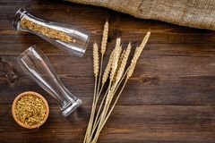 Ingredients for beer. Malting barley in beer glass on wooden background top view copyspace. Ingredients for beer. Malting barley in beer glass on wooden Royalty Free Stock Images