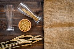 Ingredients for beer. Malting barley in beer glass on wooden background top view mockup. Ingredients for beer. Malting barley in beer glass on wooden background Stock Image