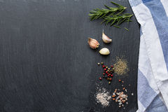 Ingredients on black stone table. Cooking ingredients and spices on a black stone background with kitchen cloth stock images