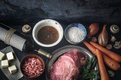 Ingredients for Boeuf Bourguignon on the  dark stone  table top view Stock Photos