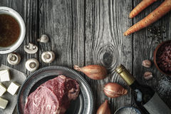 Ingredients for Boeuf Bourguignon on the old wooden table horizontal stock image