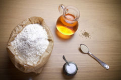 Ingredients for bread with saffron: flour, saffron water, yeast Royalty Free Stock Photography