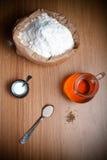 Ingredients for bread with saffron: flour, saffron water, yeast Stock Image